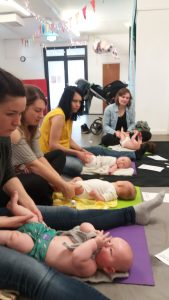 picture of a group of mums and their babies during a baby massage class