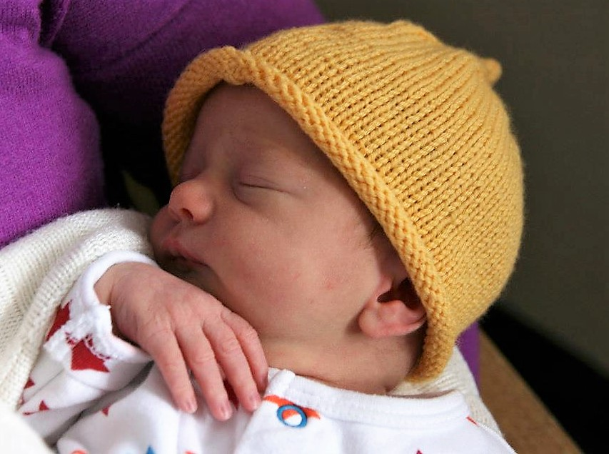 Baby Sleeping, yellow hat